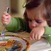 Little girl learning to eat