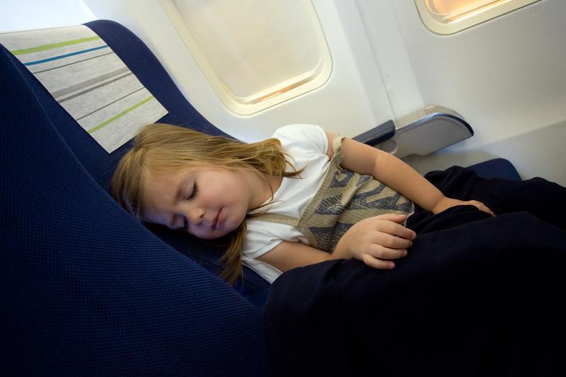 Little Girl Asleep in an Airplane Seat