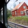 A typical Scandinavian house through the train window