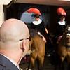 Bald security guard looking at the alguacilillos at the beginning of the initial parade of a bullfight