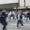 Riot policemen acting against Spurs fan, Seville, Spain
