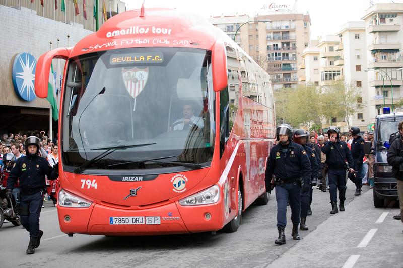 Riot policemen escorting the Sevilla FC bus on its way to the stadium
