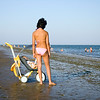 Woman on the beach with her baby