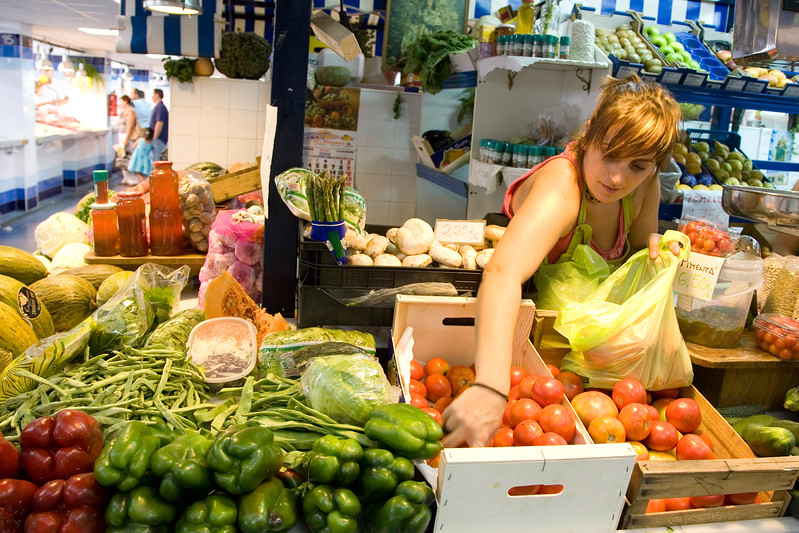 Greengrocer girl in a market, Spain