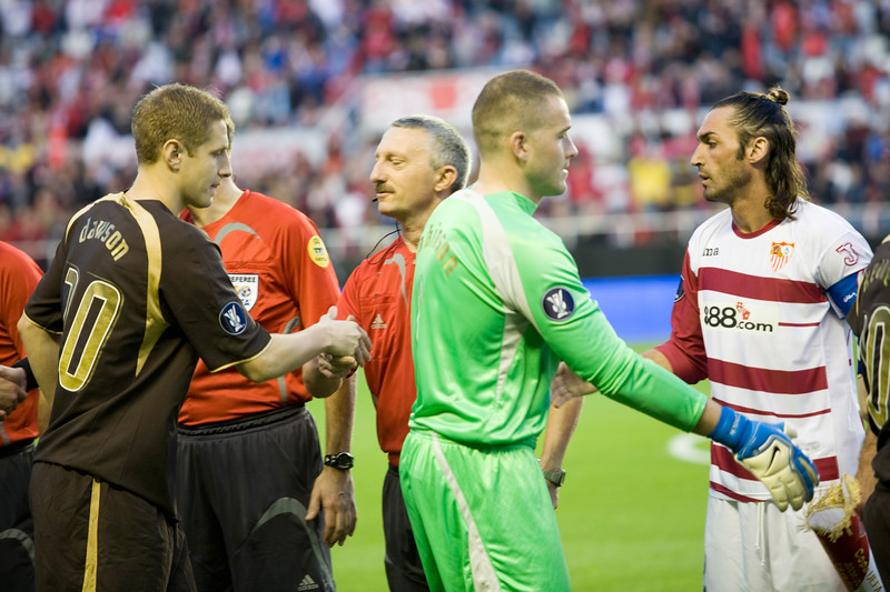 Both teams players and referees shaking hands