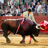 Curro Diaz performing naturales or left-hand passes during a bullfight in Seville