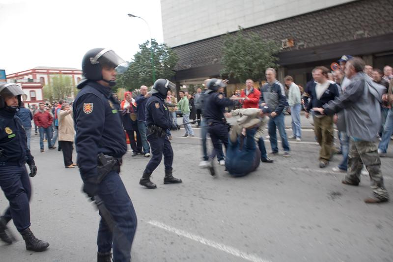 Riot policemen acting against Spurs fan, Seville, Spain