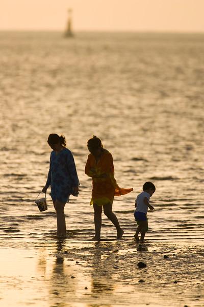 Family group on the beach, Spain