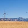 Windmills in front of Granite Peak in Utah