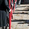 Brotherhood members bearing candles. Corpus Christi procession, Seville, Spain, 2009.