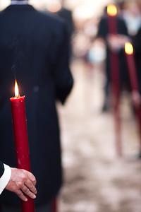 Brotherhood members bearing candles, Corpus Christi procession, Seville, Spain, 2009.