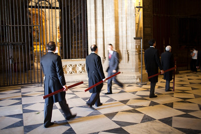 Brotherhood members bearing candles at the end of Corpus Christi procession, Seville Cathedral, Spain, 2009.