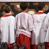 Kneeling altar boys praying at the end of Corpus Christi procession, Sagrario church, Seville, Spain, 2009.