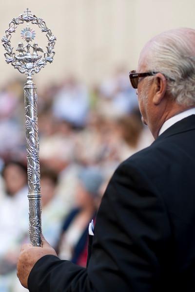 Brotherhood member with a stick, Corpus Christi procession, Seville, Spain, 2009.