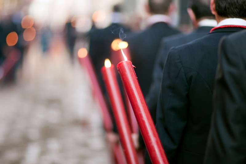 Brotherhood members bearing candles, Corpus Christi procession, Seville, Spain, 2009.