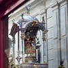 Silver float with Baby Jesus reflected on a shop window, Corpus Christi procession, Seville, Spain, 2009.