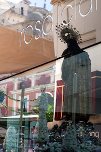 Virgin Mary statue reflected on a shop window, Corpus Christi procession, Seville, Spain, 2009.