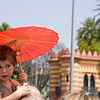 Little lady looking at the parade under an umbrella. Taken in Seville (Andalusia, Spain) during a military parade of the Spanish army, 28 May 2006.