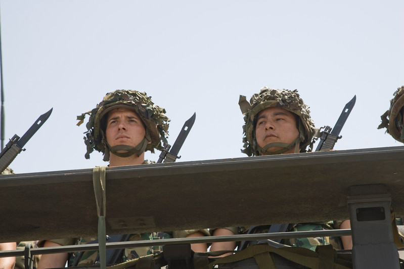 Soldiers on a carrier. Taken in Seville (Andalusia, Spain) during a military parade of the Spanish army, 28 May 2006.