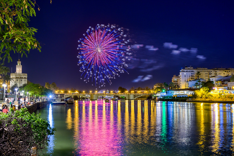 Fireworks by the Guadalquivir river, closing ceremony of April Fair 2019, Seville, Spain.