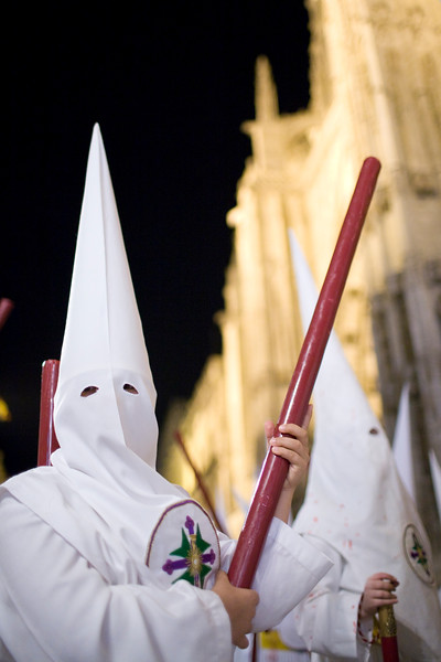 Young penitents bearing candles, Holy Week, Seville, Spain