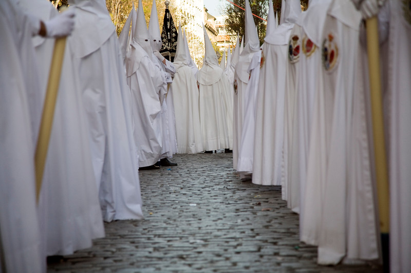 Row of hooded penitents, Palm Sunday, Seville, Spain