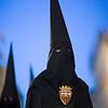 Hooded penitent against a dusk sky, Holy Week 2008, Seville, Spain
