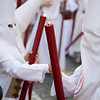 Young hooded penitents bearing red candles, Seville, Spain, Holy Week 2008