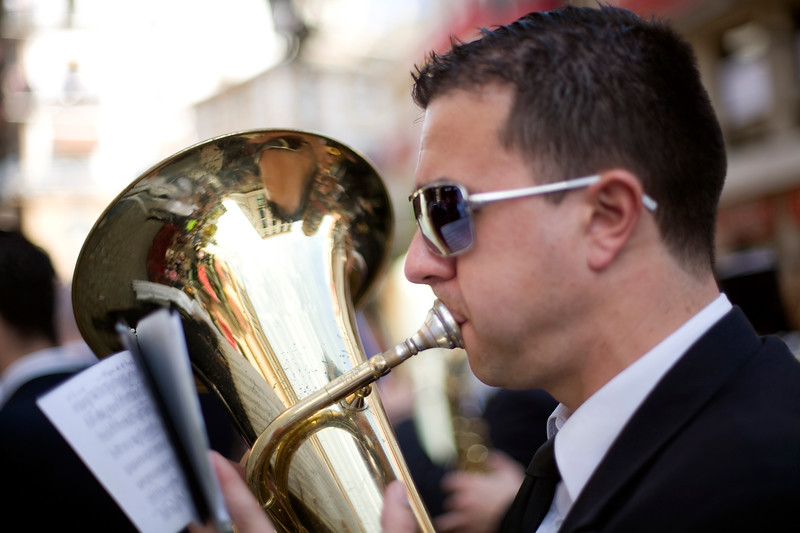 Musician blowing a tuba, Seville, Spain