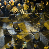Aerial view of penitents bearing wooden crosses on Good Friday dawn, Seville, Spain