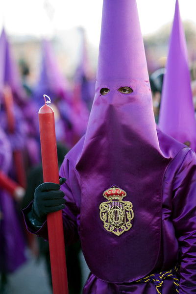 Penitent bearing candle, Good Friday, Seville, Spain