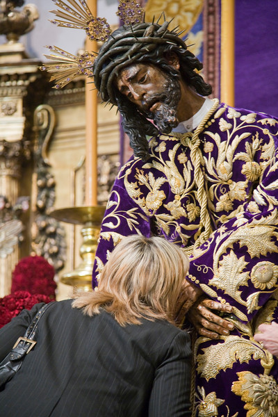 A woman kissing the hands of Jesus del Gran Poder image, Seville, Spain