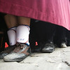 Feet of float bearers during a Holy Week procession, Seville, Spain