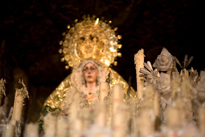 The float candles and wax flowers of Our Lady of Esperanza Macarena after the Good Friday procession, Seville, Spain