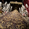 Rear view of a Holy Week float with the embroidered Virgin's cloak and the candelabra and canopy, Seville, Spain