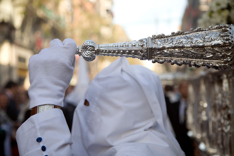 """A """"maniguetero"""" or penitent who grabs the float handle, Seville, Spain, Holy Week 2008"""