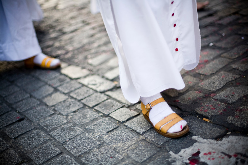Feet of penitents on the pavement, Holy Week 2008, Seville, Spain