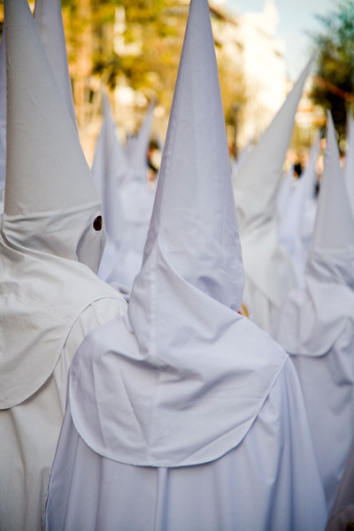 Back view of hooded penitents, Palm Sunday, Seville, Spain