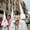 Penitents posing before the procession, Palm Sunday, Seville, Spain