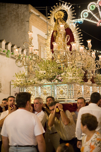 Men bearing a float with the Virgin image, Castilleja del Campo, Spain