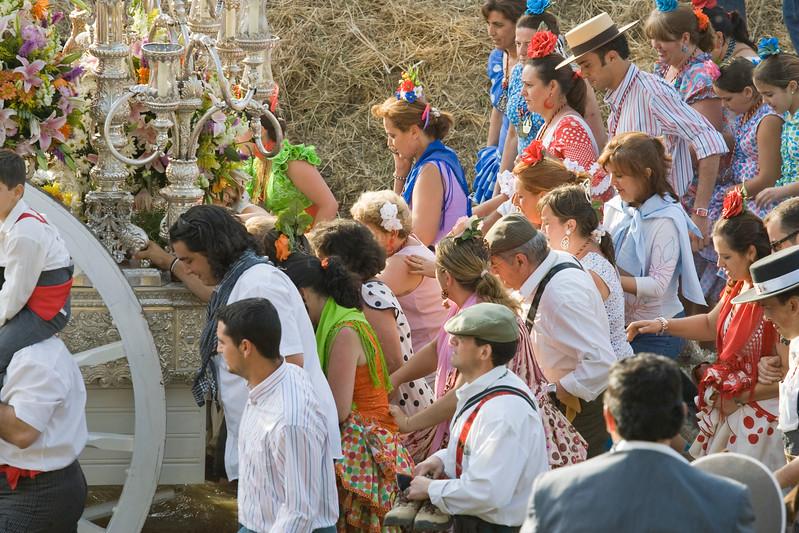 Pilgrims walking behind the Virgin banner or simpecado