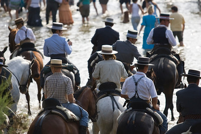 Riding pilgrims crossing the river