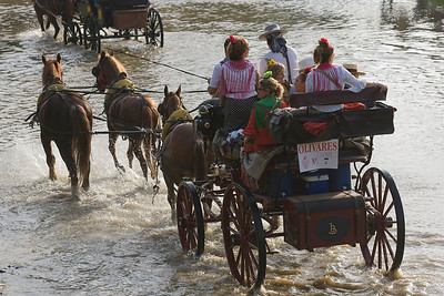 Pilgrims crossing the river on carriages