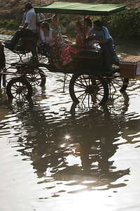 Pilgrims on a carriage crossing the river