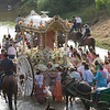 The cart with the simpecado crossing the river