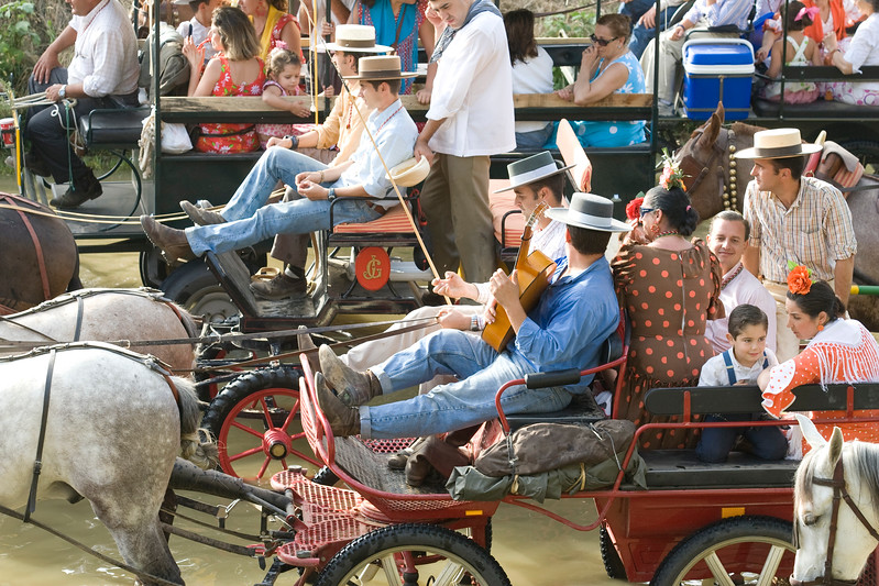 Pilgrims singing on carriages