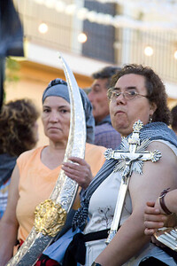 Women carrying holy valuables belonging to the Virgin of El Rocio. They carry them as a penitence during the walking pilgrimage from Almonte to El Rocio shrine (province of Huelva, Andalusia, Spain) during the festival known as Rocio chico or minor Rocio. May 2006.