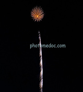 Orange Fireworks with With white Streamer