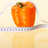 Orange Pepper with Tape Measure