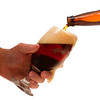 Pouring a Cold Glass of Dark Beer Isolated on White